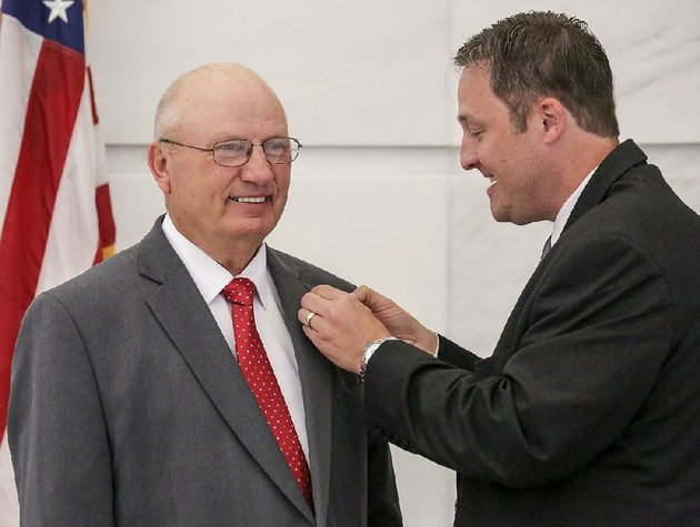 donald-ragland-of-marshall-left-and-speaker-of-the-arkansas-house-jeremy-gillam-of-judsonia-chuckle-as-gillam-struggles-with-a-house-lapel-pin-ragland-was-sworn-in-as-representative-for-house-district-83-during-a-ceremony-in-the-state-capitol-rotunda-tuesday-morning-in-little-rock