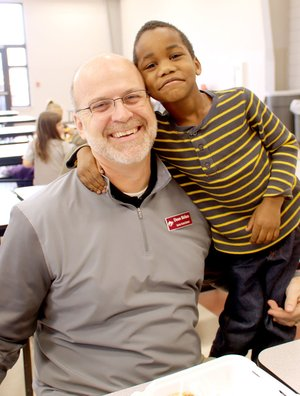 LYNN KUTTER ENTERPRISE-LEADER Malachi Baker, who is in kindergarten at Lincoln Elementary, clowns around with his lunch buddy and mentor, Deon Birkes, assistant principal for Lincoln High School and the district's athletic director.