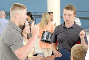 MARK HUMPHREY ENTERPRISE-LEADER Zeke Laird (left), a 2017 Prairie Grove graduate and Army officer in training at West Point, gives some advice to Javan Jowers, a 2018 Farmington graduate who will attend the U.S. Air Force Academy. The two athletes competed against each other in high school as part of the storied Farmington vs. Prairie Grove rivalry.