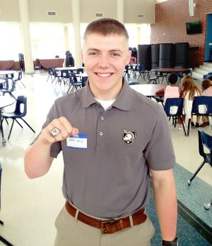 MARK HUMPHREY ENTERPRISE-LEADER Zeke Laird, a 2017 Prairie Grove graduate and Army officer in training at West Point, displays a National Championship ring won while playing offensive lineman as part of the Army's Sprint Football team.
