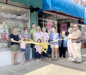 COURTESY PHOTO Prairie Grove Area Chamber of Commerce recently sponsored a ribbon cutting for Junk Pink, a new store with boutique clothing, homegoods and gifts. Junk Pink is located at 121 E. Buchanan St., and is owned by Kyle and Sarah Stokes.