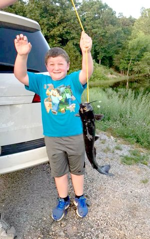 Seven-year-old Carter Musteen's first catch was also his second catch. He was fishing for trout at Lake Brittany when he caught this catfish -- twice.