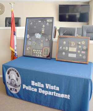 Keith Bryant/The Weekly Vista The Fraternal Order of Police and Bella Vista Police Department both prepared shadowboxes to celebrate Lt. Barb Shrum's retirement.