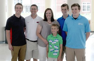 MARK HUMPHREY ENTERPRISE-LEADER Javan Jowers (left), a 2018 Farmington graduate, posses with his family, Nathan Jowers, dad; Pam Jowers, mother; and brothers, Jaxton, Jared and Josh, during a sendoff for service academy appointees hosted by Congressman Steve Womack, of Rogers, on Saturday at Har-Ber High School in Springdale. Javan will attend the U.S. Air Force Academy, at Colorado Springs, Colo.
