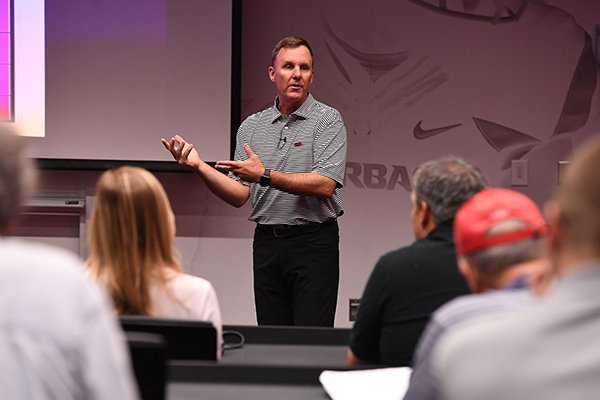 Arkansas coach Chad Morris talks to reporters during a media coaching clinic at Fred W. Smith Center in Fayetteville.