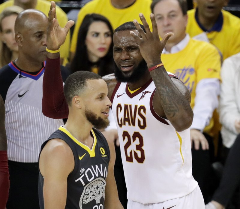 d5626da7c7e5 Cleveland Cavaliers forward LeBron James (23) reacts next to Golden State  Warriors guard Stephen Curry during the first half of Game 2 of  basketball s NBA ...
