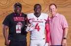 Anthony and Aaron Young with Coach Chad Morris.
