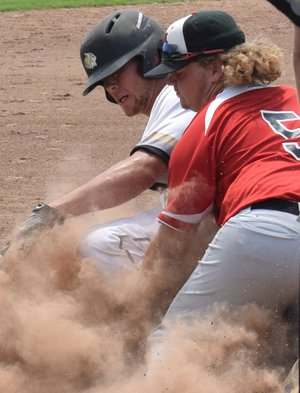 RICK PECK/SPECIAL TO MCDONALD COUNTY PRESS McDonald County third baseman Izak Johnson puts the tag on a Neosho runner during McDonald County's 4-2 win on June 2 in the Carl Junction 18U Baseball Tournament.