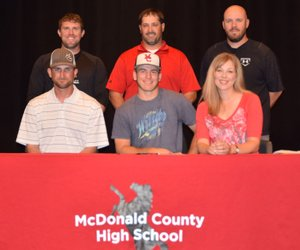 RICK PECK/SPECIAL TO MCDONALD COUNTY PRESS Ty Shaver (seated, center) recently signed a letter of intent to play baseball at Oklahoma Wesleyan University in Bartlesville, Okla. Front row right to left: James Shaver (dad), Ty Shaver and Christina Shaver (mom). Back row: MCHS baseball coaches Kellen Hoover, Nick Martin and Bo Bergen.