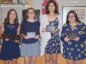 RICK PECK/SPECIAL TO MCDONALD COUNTY PRESS Members of the 2018 McDonald County High School girls' soccer team recently received awards at a banquet held at MCHS. From left to right: Kaycee Factor, Freshman of the Year and JV Most Valuable Player; Azlen Smith, Mustang Award; Nicole Salas, Most Improved; and Esmerelda Estrada, JV Defensive Player of the Year. Not present: Ava Smith, Offensive Player of the Year and Kaylee Eberley, Most Valuable Player.