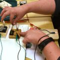 A teacher works Wednesday on an electricity project at Maker Camp.