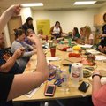 Teachers work on weaving projects Wednesday at Maker Camp.
