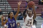 Marquesha Davis (24) of Springdale reaches to score as Coriah Beck of Fayetteville defends Tuesday, Feb. 20, 2018, during the first half in Bulldog Gymnasium in Springdale.