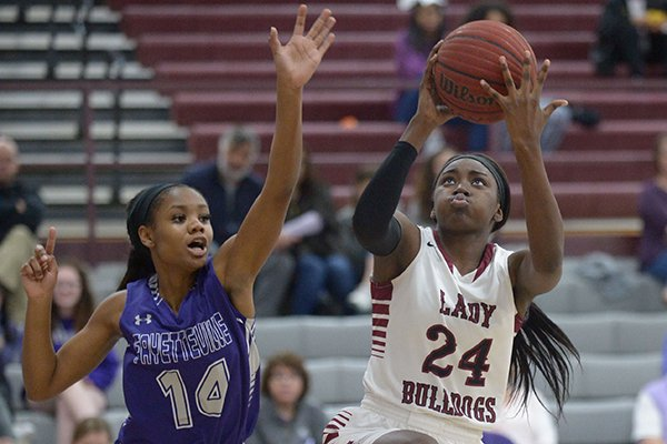 marquesha-davis-24-of-springdale-reaches-to-score-as-coriah-beck-of-fayetteville-defends-tuesday-feb-20-2018-during-the-first-half-in-bulldog-gymnasium-in-springdale