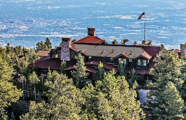 located-at-9200-feet-3000-feet-above-colorado-springs-cloud-camps-8500-square-foot-main-lodge-opened-in-2014-on-the-site-of-broadmoor-hotel-builder-spencer-penroses-private-retreat-quality-features-include-chinked-logs-hand-hewn-beams-and-local-stone-fireplaces