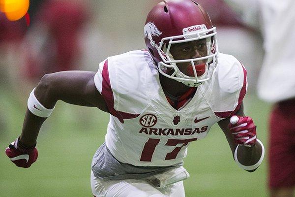 Receiver Kofi Boateng runs through drills at Arkansas football practice on Saturday, April 29, 2017, inside Walker Pavilion in Fayetteville.