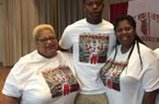 Arkansas QB commit KJ Jefferson pose with his grandmother (left) and mother after announcing for the Razorbacks on May 18.