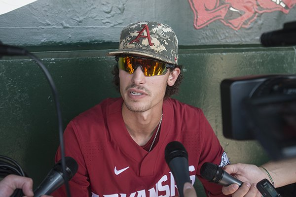 Blaine Knight, Arkansas pitcher, talks to the press Friday, June 8, 2018, during practice for the NCAA Fayetteville Super Regional at Baum Stadium.