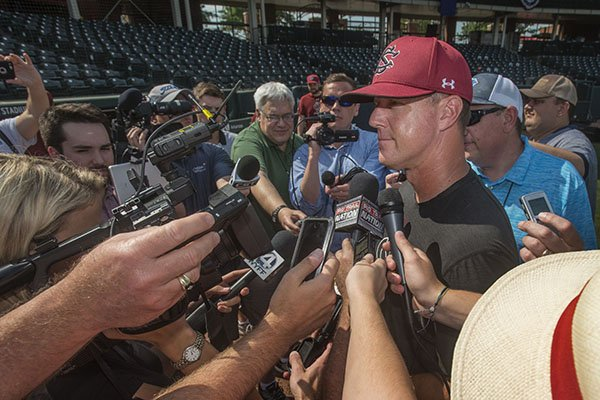 South Carolina coach Mark Kingston talks to reporters following practice Friday, June 8, 2018, in Fayetteville.