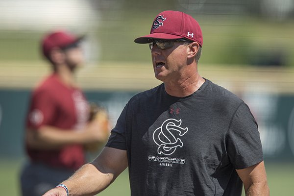 South Carolina coach Mark Kingston talks to players during practice Friday, June 8, 2018, in Fayetteville.