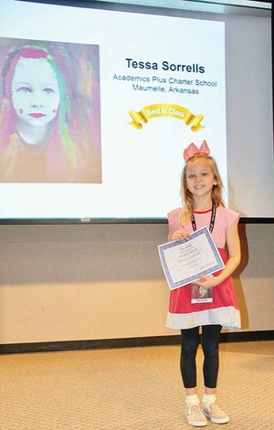 Tessa Sorrells, a second-grader at Academics Plus Charter School in Maumelle, shows her Best in Class award in the Young Arkansas Artists exhibition. She received the award with a mixed-media 