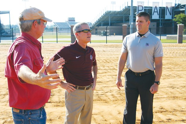benton-school-district-plant-manager-kevin-chastain-left-talks-with-superintendent-mike-skelton-and-athletic-director-scott-neathery-on-thursday-morning-at-the-site-of-the-new-panthers-baseball-stadium-on-may-14-the-benton-school-board-approved-a-bid-of-nearly-4-million-from-nabholz-construction-to-relocate-the-baseball-stadium-to-the-benton-athletic-sports-complex-the-new-stadium-will-parallel-the-softball-field-which-was-built-in-2009