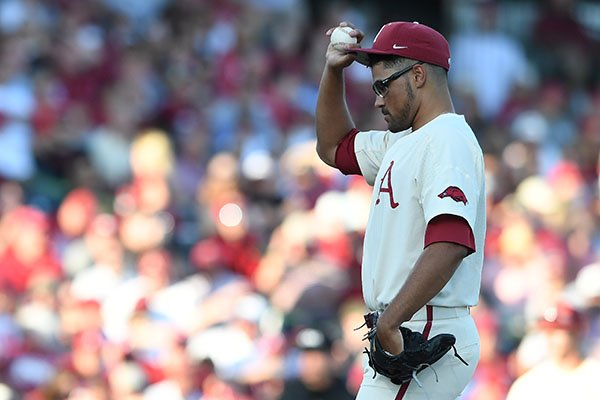 Arkansas pitcher Isaiah Campbell reacts after loading the bases during an NCAA Tournament game against Dallas Baptist on Sunday, June 3, 2018, in Fayetteville.