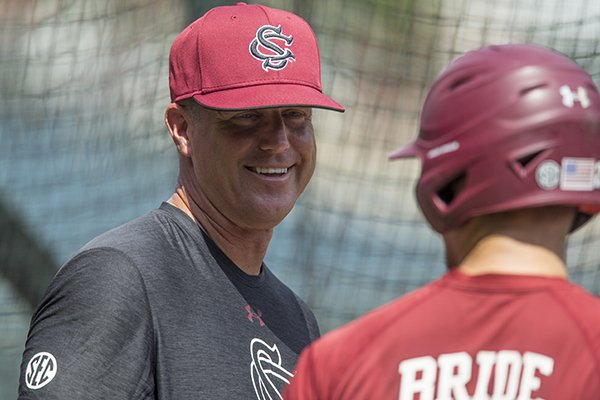 South Carolina coach Mark Kingston talks to third baseman Jonah Bride during practice Friday, June 8, 2018, in Fayetteville.