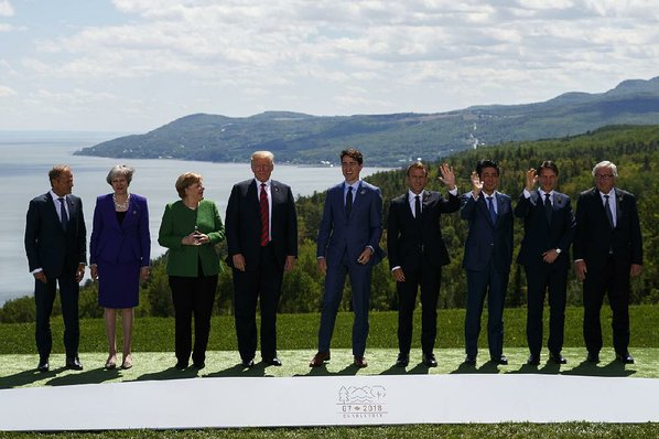 "Credit AP  EVAN VUCCI					Donald Trump and other G-7 leaders pose for their ""family portrait"" Friday in Charlevoix Quebec"