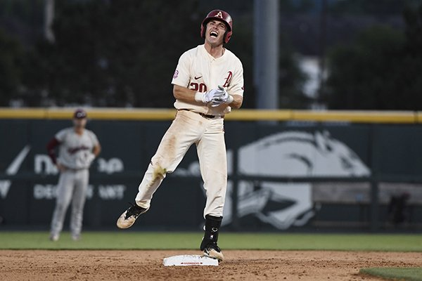 Arkansas baserunner Carson Shaddy celebrates after hitting a three-run double against South Carolina in the seventh inning of an NCAA college baseball tournament super regional baseball game in Fayetteville, Ark., Saturday, June 9, 2018. (AP Photo/Michael Woods)