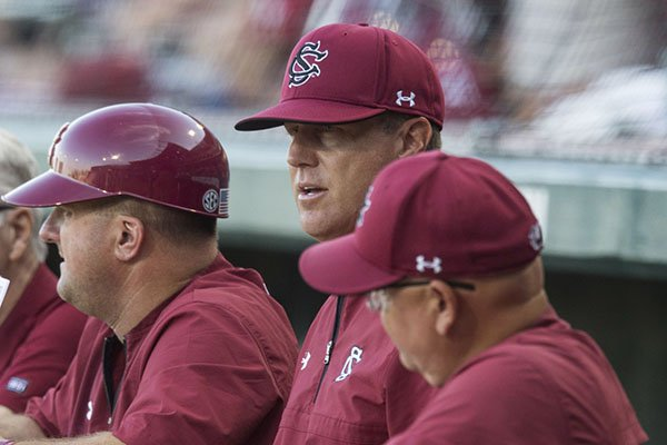 South Carolina coach Mark Kingston watches from the dugout during an NCAA Tournament game against Arkansas on Saturday, June 9, 2018, in Fayetteville.