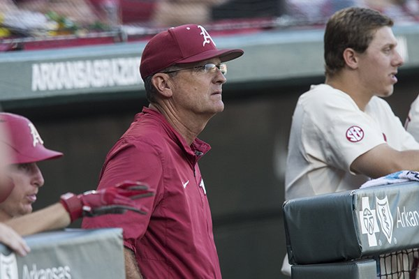 Arkansas coach Dave Van Horn watches from the dugout during an NCAA Tournament game against South Carolina on Saturday, June 9, 2018, in Fayetteville.