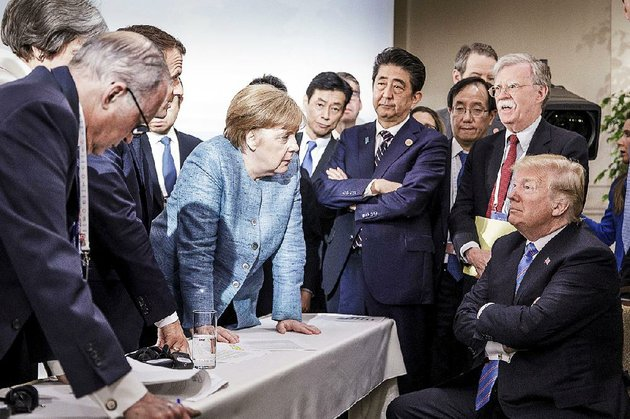 german-chancellor-angela-merkel-speaks-to-president-donald-trump-as-japanese-prime-minister-shinzo-abe-us-national-security-adviser-john-bolton-top-right-and-others-watch-saturday-during-the-g-7-summit-in-la-malbaie-quebec