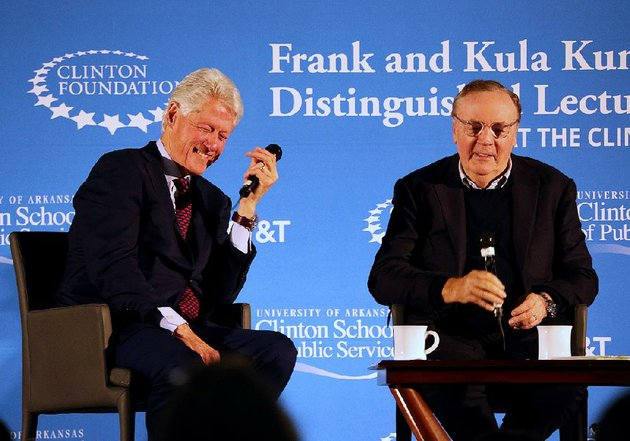 former-president-bill-clinton-left-shares-a-laugh-with-author-james-patterson-while-talking-about-the-president-is-missing-the-book-they-co-wrote-during-a-panel-discussion-saturday-in-little-rock