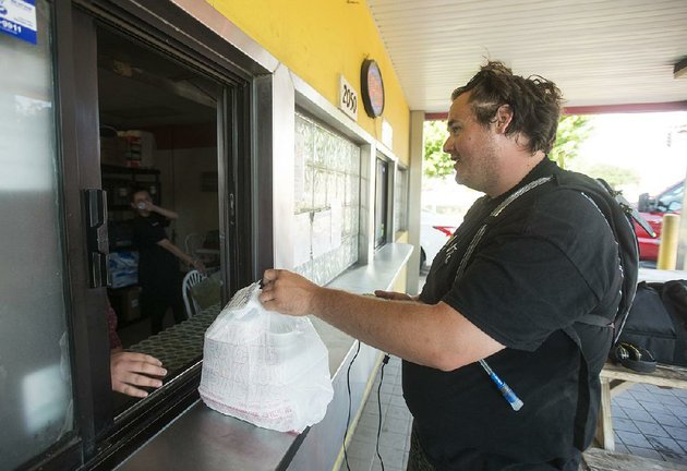 eddie-bouchez-a-driver-for-the-food-delivery-company-waitr-picks-up-an-order-wednesday-at-mangos-gourmet-taco-shop-in-fayetteville
