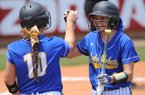 Sheridan's Maggie Hicks (right) celebrates after scoring a run with Corbin Talbert against Benton Saturday, May 21, 2016, during the Class 6A state championship game at Bogle Park in Fayetteville.