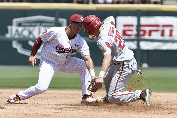 South Carolina's second baseman Justin Row tries to put the tag on Arkansas baserunner Carson Shaddy as he steals second base in the second inning of an NCAA college baseball tournament super regional baseball game in Fayetteville, Ark., Sunday, June 10, 2018. (AP Photo/Michael Woods)