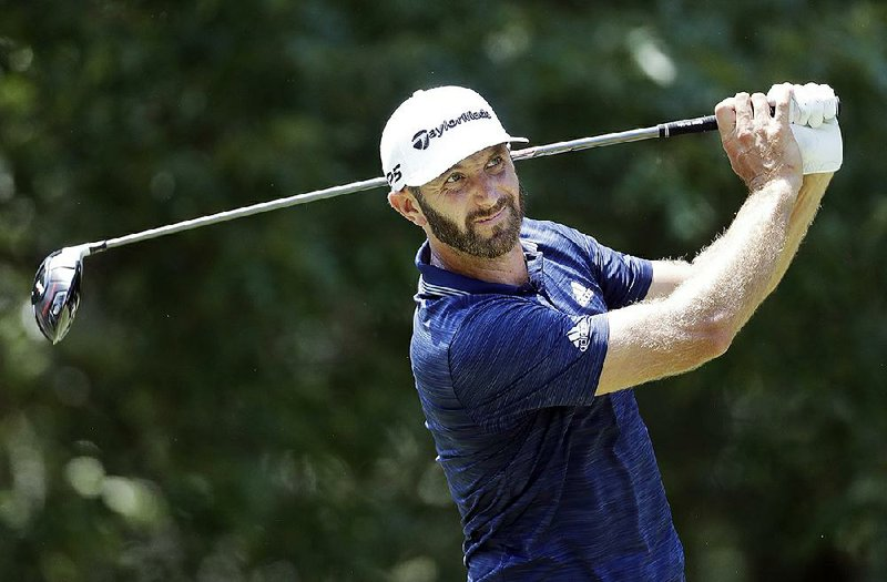 ab3c7e38720 Dustin Johnson watches his drive on the seventh hole during the final round  of the St. Jude Classic golf tournament Sunday
