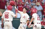Arkansas second baseman Carson Shaddy (20) celebrates after hitting a home run during the first inning of an NCAA Tournament game against South Carolina on Monday, June 11, 2018, in Fayetteville.