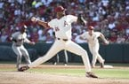 Arkansas pitcher Isaiah Campbell throws a pitch against South Carolina in the first inning of an NCAA college baseball tournament super regional baseball game in Fayetteville, Ark., Monday, June 11, 2018. (AP Photo/Michael Woods)