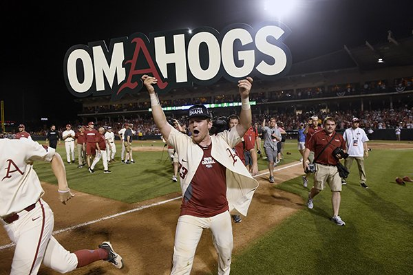Arkansas catcher Grant Koch celebrates after the Razorbacks 14-4 win over South Carolina during an NCAA college baseball tournament super regional baseball game in Fayetteville, Ark., Monday, June 11, 2018. (AP Photo/Michael Woods)