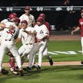 The Razorbacks celebrate after defeating South Carolina 14-4 on Monday in the Fayetteville Super Reg...