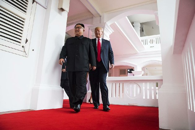 president-donald-trump-and-kim-jong-un-of-north-korea-head-to-a-private-one-on-one-meeting-in-singapore