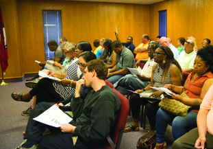 Attendees at the June 6 Columbia County delinquent tax auction (pictured) hunt for land deals as they try to outbid one another. Official figures were released Monday for the sale. In the report, State Land Commissioner John Thurston's office stated that $31,469 was netted from the local auction.