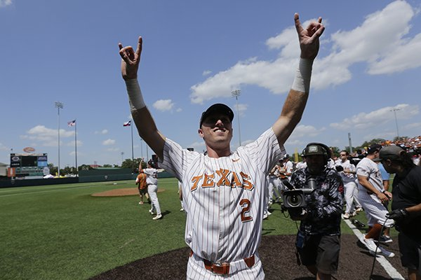 Texas infielder Kody Clemens (2) and his teammates celebrate their win over Tennessee Tech in an NCAA college super regional baseball game, Monday, June 11, 2018, in Austin, Texas. Texas won 5-2. (AP Photo/Eric Gay)