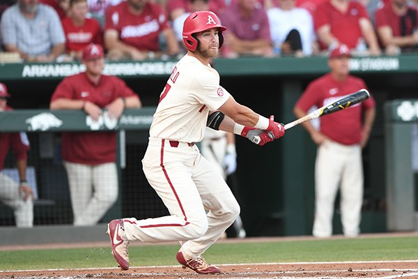 Luke Bonfield singles to right field in Arkansas' 14-4 win over South Carolina Monday June 11, 2018 during the NCAA Super Regional at Baum Stadium in Fayetteville.