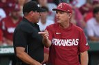 Arkansas coach Dave Van Horn, right, talks with home plate umpire Billy Haze during an NCAA Tournament game against South Carolina on Monday, June 11, 2018, in Fayetteville.
