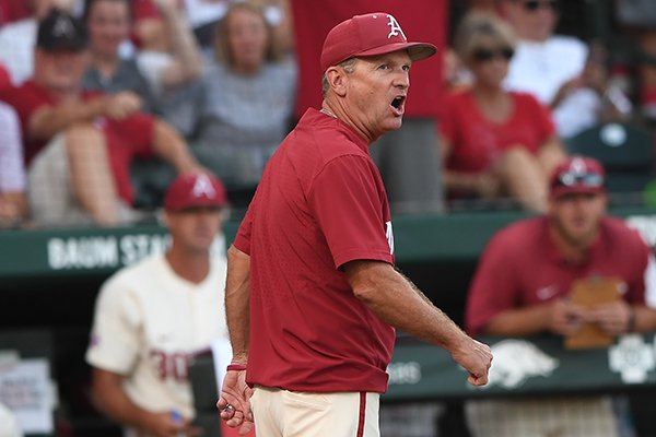 Arkansas coach Dave Van Horn walks off the field after arguing a call during an NCAA super regional game against South Carolina on Monday, June 11, 2018, in Fayetteville.