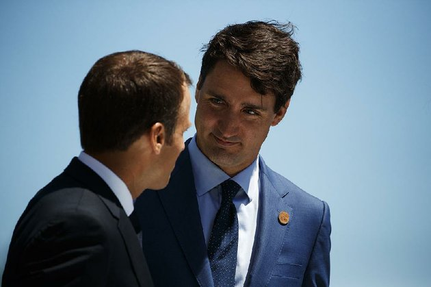 french-president-emmanuel-macron-left-and-canadian-prime-minister-justin-trudeau-talk-friday-at-welcoming-ceremonies-for-group-of-seven-leaders-in-charlevoix-quebec