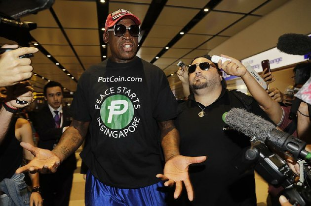 former-nba-basketball-player-dennis-rodman-and-chris-volo-right-arrive-at-singapores-airport-on-tuesday
